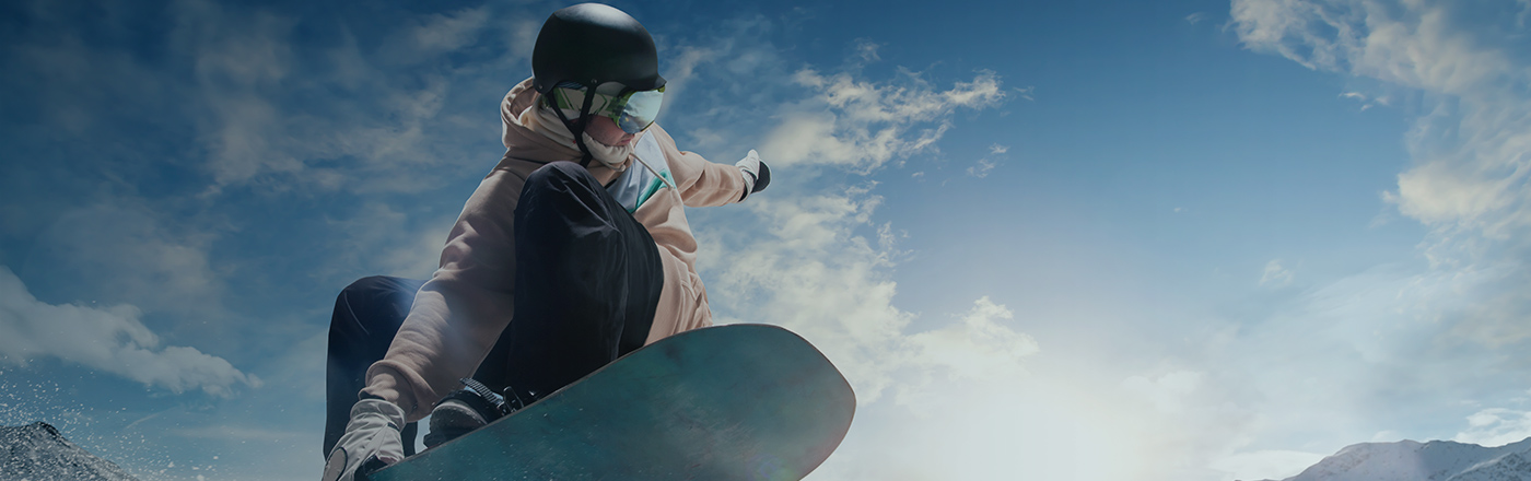 Angled view of someone jumping with a snowboard