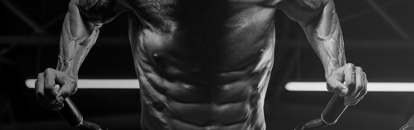 Close up of defined muscles and abs during a workout